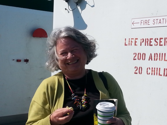 Mom on ferry with popcorn.